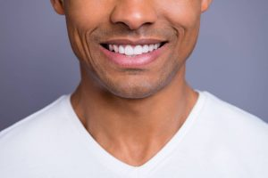 African American man with healthy straight clean teeth stock photo